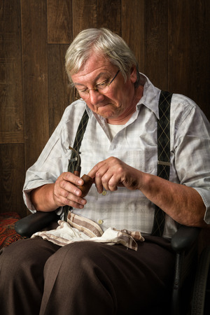 pensioner: Old and gray pensioner smoking his pipe Stock Photo