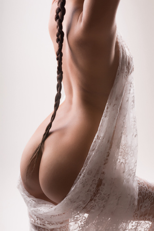 Fine art nude portrait of a young woman with long braid Stock Photo