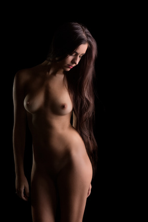 Relaxed young naked woman with very long black hair