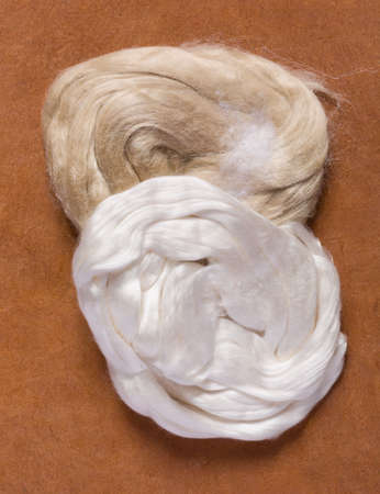 unprocessed: White and beige silk tops in their raw unprocessed form
