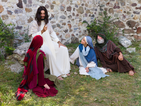 bible story: Jesus preaching to a group of people - historical reenactment