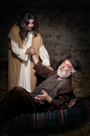lame: Jesus healing the lame or crippled man Stock Photo