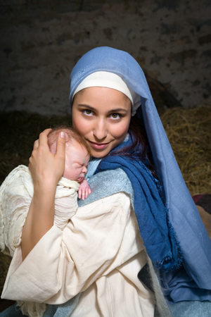 bible christmas: Live Christmas nativity scene in an old barn - Reenactment play with authentic costumes.  The baby is a (property released) doll.