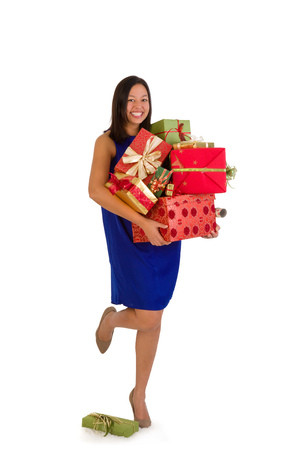 Attractive young woman holding too many Christmas presents photo