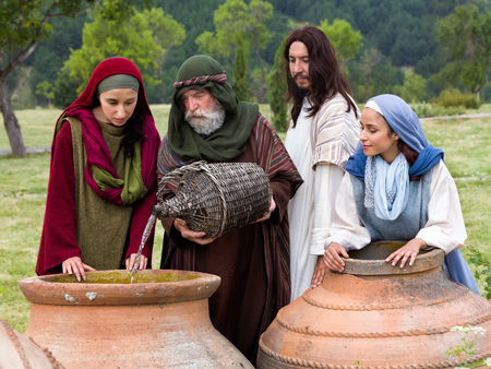 Biblical scene play of the miracle of transformation of water into wine