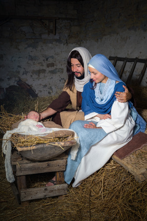 child jesus: Live Christmas nativity scene in an old barn - Reenactment play with authentic costumes.  The baby is a (property released) doll.