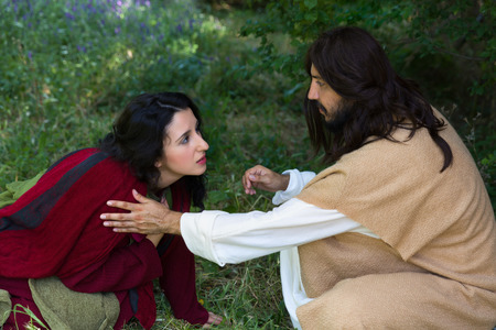 Repentant sinner woman touching the robe of Jesus, asking for forgiveness and healing