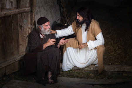 jesus: Jesus healing the lame or crippled man Stock Photo