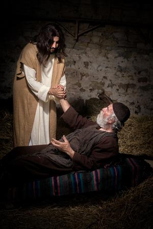 Jesus healing the lame or crippled man Standard-Bild