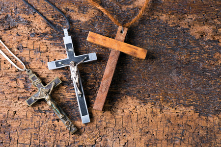 cleric: Religious antique crosses, metal for nuns and wooden for monks Stock Photo