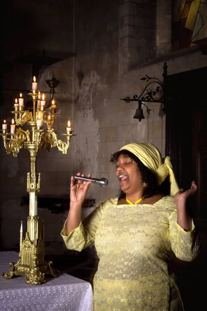hymn: Gospel singer in a dark medieval church with 17th century interior