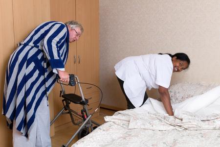 Naughty grandpa in nursing home admiring the nurses butt Imagens