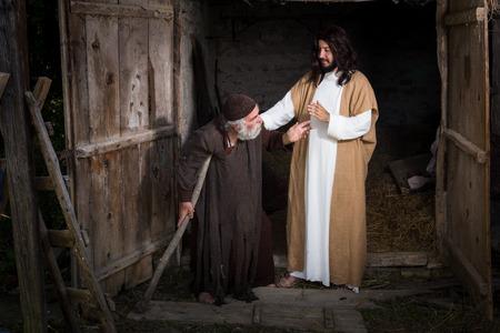 Jesus healing the lame or crippled man Stock fotó