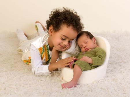 ethiopian ethnicity: Proud Ethiopian toddler in ethnic costume posing with his newborn brother