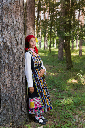 Young woman posing in traditional Bulgarian costume