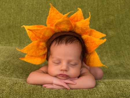 ethiopian ethnicity: Adorable African newborn baby of 7 days old sleeping on a green blanket