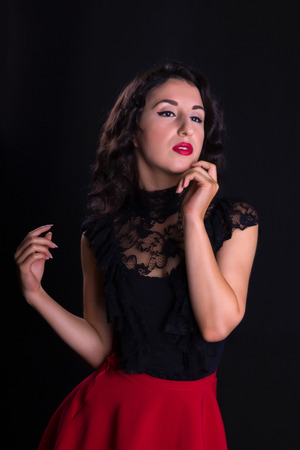 Stunning black haired model posing in vintage style like a hollywood actress photo