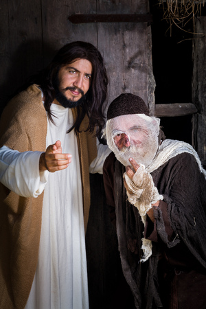 Bible scene historical reenactment play with a leprosy man and Jesus