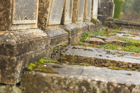 Abandoned old graves in a medieval French graveyard Stock Photo