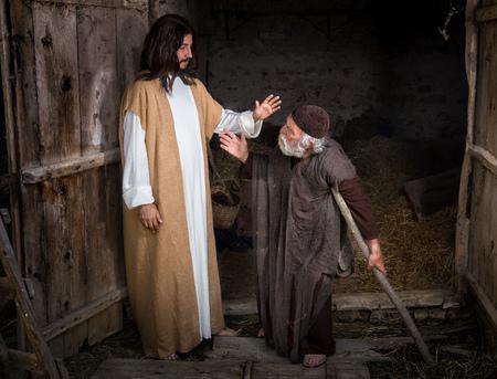 Jezus geneest de kreupele of kreupele man Stockfoto
