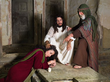 Mary of Bethany crying of shame and anointing Jesus' feet, while Judas is protesting against the waste