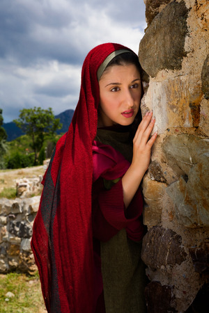 Mary Magdalene standing at the entrance of the empty tomb of Jesus on Easter morning Stock Photo