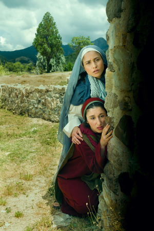 Scared Mother Mary and Mary Magdalene standing at the entrance of the empty tomb of Jesus on Easter morning