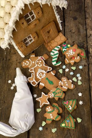 Assortment of gingerbread cookies on a rustic wooden table Reklamní fotografie