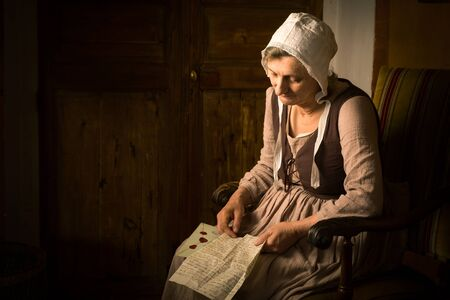 Portrait of a ature woman reading in an Old Master or Renaissance style