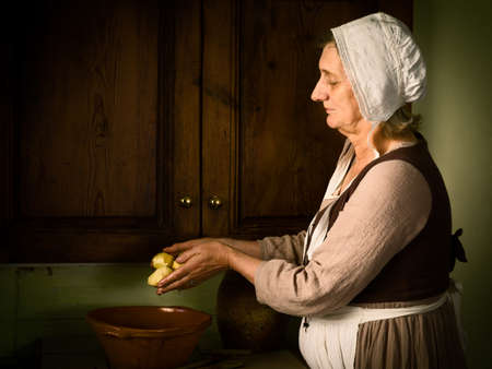 Old Master style Renaissance portrait of a woman preparing food in an antique kitchen