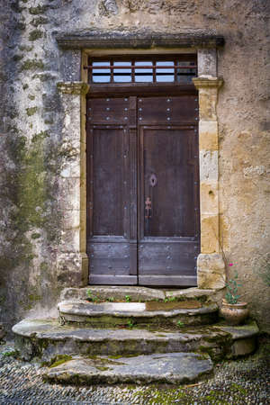 Antique wooden doors and gates of a French medieval chateau or castle with property release