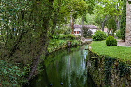 Moat around a French medieval chateau or castle with property release