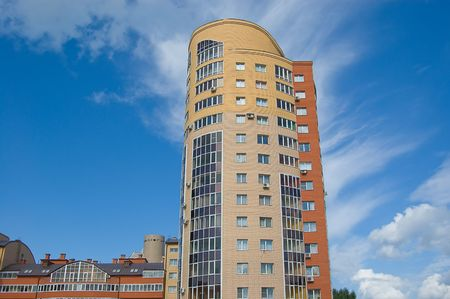 Multistory housing estate of red and yellow bricks in blue sky photo