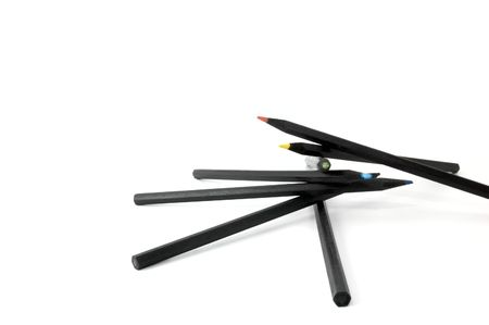 Spiral composition of multicolored pencils made of black wood isolated on white background photo
