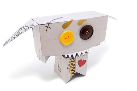agitation: Toothy cardboard figurine with expressive face Stock Photo