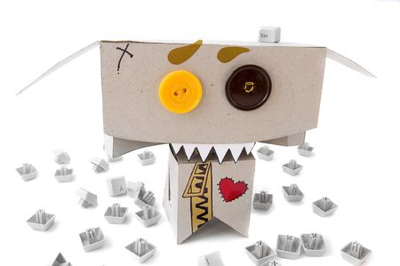 toothy: Toothy cardboard toy surrounded by keyboard buttons