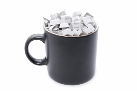 No rest in office: keyboard keys in coffee mug photo