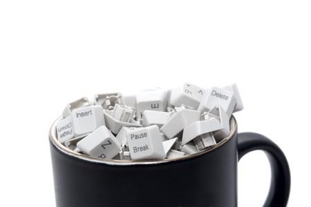 No rest on office work: keyboard keys in coffee mug photo