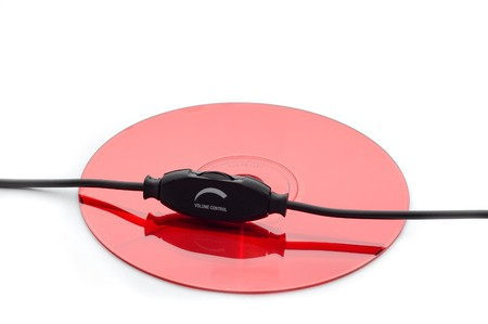 cdrom: Volume control knob on red cd (dvd) isolated Stock Photo