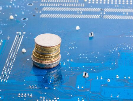 monetize: Money from Internet: coins over technological background