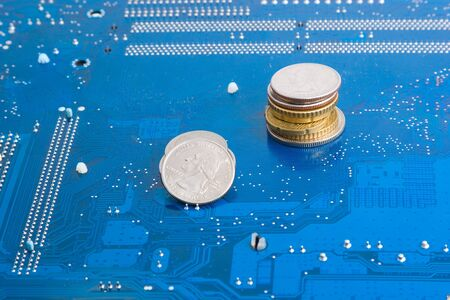 monetizing: Make money on electronic commerce: dollar and euro coins on motherboard