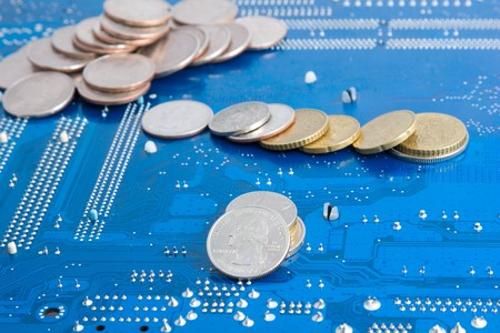 Internet money - dollar and euro coins on technological background (computer motherboard)