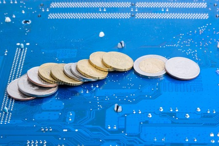monetizing: Electronic money: dollar and euro coins over technological background