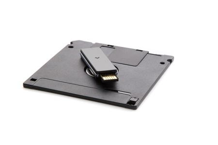 the outdated: Outdated and modern: floppy disk and usb drive