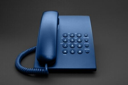 Black office phone with cord isolated on black background and toned in green colour Stock Photo - 4431027
