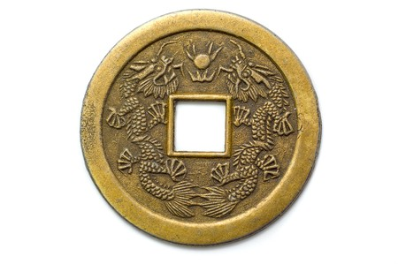 antique coins: Old chinese feng shui lucky coin for good fortune and success. Stock Photo
