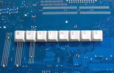 bijschrift: Technologie business: moederbord achtergrond en BUSINESS bijschrift Stockfoto