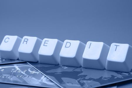 Use credit resourse: CREDIT caption over plastic cards photo