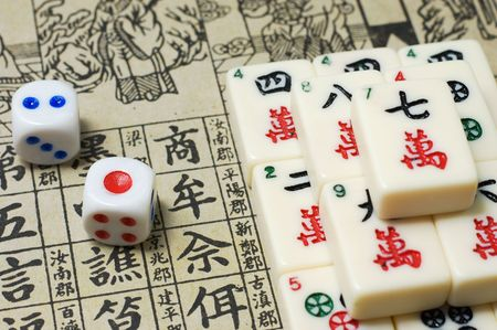 mahjong: Mahjong - asian game with dices and hieroglyphical background Stock Photo