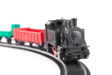 Train arriving: old toy railroad isolated photo